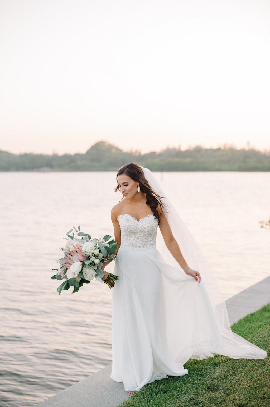 Organic Greenery Inspired Neutral Pastel Wedding Ceremony Arch for Outdoor Waterfront Siesta Key Wedding | Sarasota Wedding Planner Jennifer Matteo Events