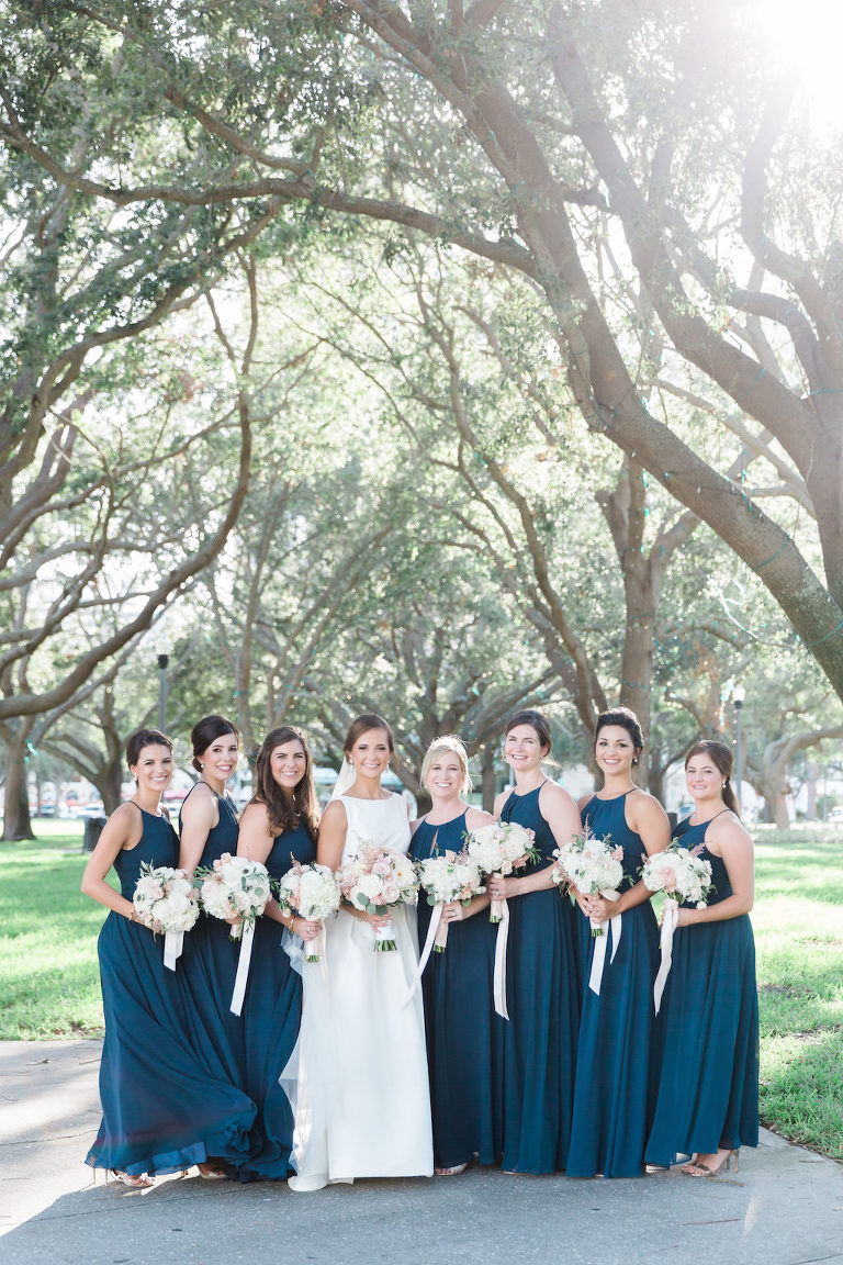 Outdoor Park Bridal Party Portrait, Bridesmaids in Floorlength Azazie Matching Halter Blue Dresses with White and BLush Pink Bouquets with Long RIbbon