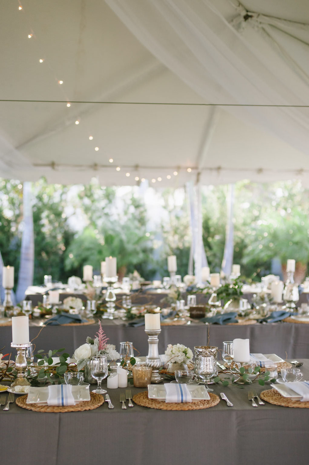 Outdoor Tented Wedding Reception with Organic Greenery Inspired Decor, Long Feasting Tables and Candle Centerpieces | Sarasota Wedding Planner Jennifer Matteo Event Planning