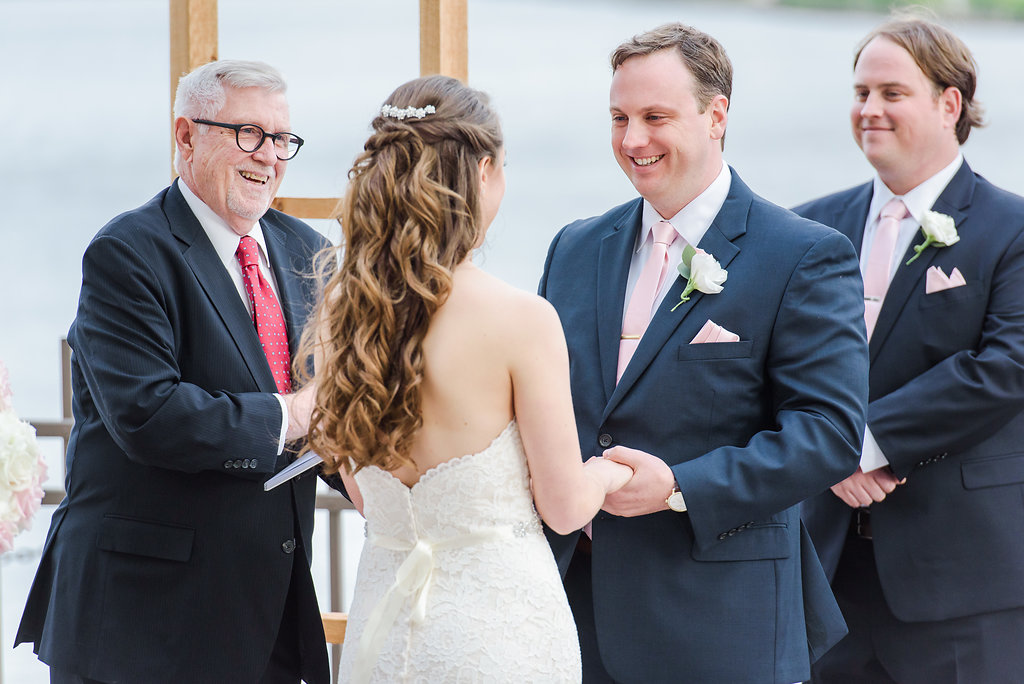 f383a06d71ec Outdoor Wedding Ceremony Portrait, Groom and Groomsmen in Navy Blue Suits  with Blush Pink Ties and Pocket Squares, and White Rose Boutonniere