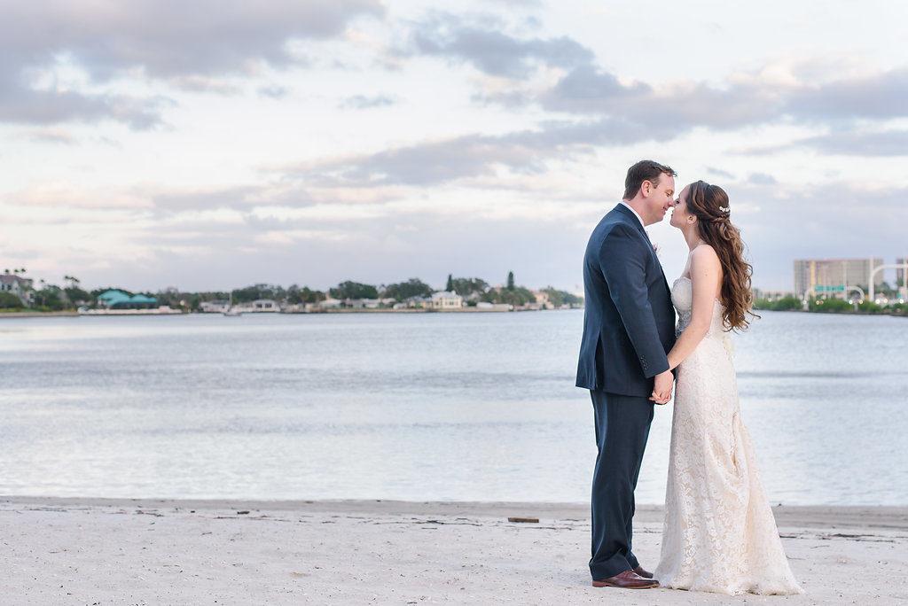 Beach Wedding Portrait, Bride in Lace Stella York Dress, Groom in Navy Blue Suit | Waterfront Hotel Wedding Venue The Westin Tampa Bay