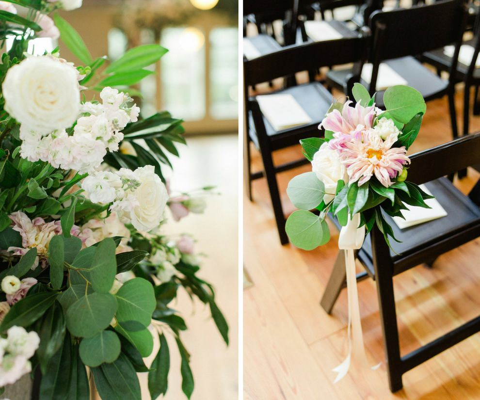Indoor Wedding Ceremony Decor with White and BLush Flowers with Natural Greenery in Tall Planter, and Mismatched Dark Wooden Chairs with Pink Flowers and Long Ribbon