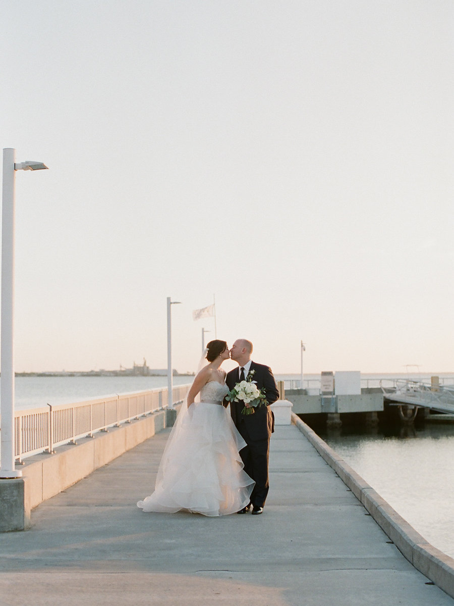 Outdoor Waterfront Wedding Portrait, Bride in Layered Strapless Ballgown Dress with White Rose and Greenery Bouquet | Tampa Wedding Venue The Westshore Yacht Club | Planner UNIQUE Weddings and Events