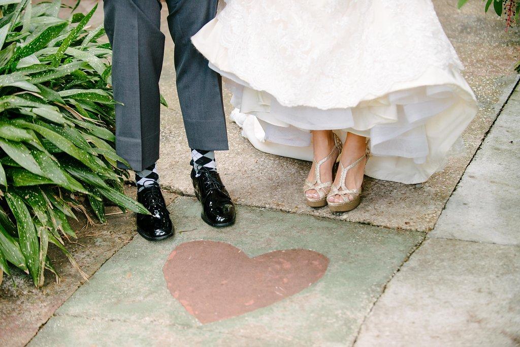 Outdoor Garden Bride and Groom Portrait, Bride in Open Toe Strappy Silver Sandal Wedding Shoes, Groom with Grey Argyle Socks