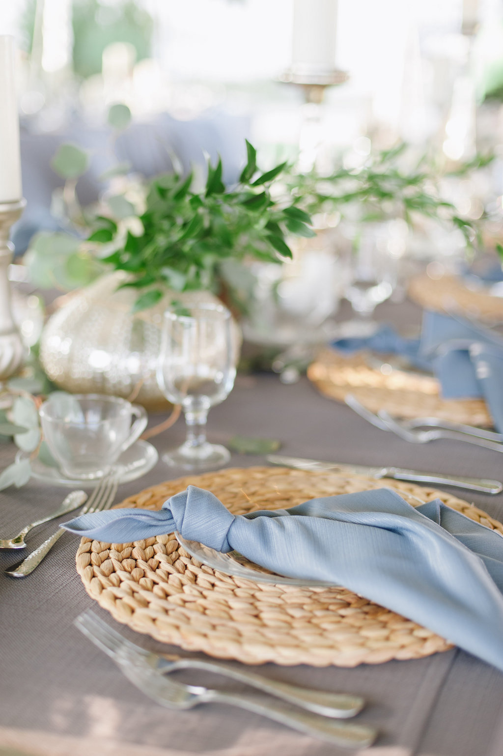 Outdoor Tented Wedding Reception with Organic Greenery Inspired Decor, Long Feasting Tables, Wicker Placemat Chargers and Candle Centerpieces | Sarasota Wedding Planner Jennifer Matteo Event Planning