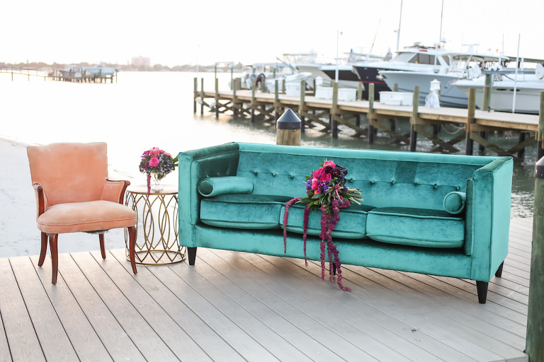 Outdoor Dockside Waterfront Wedding Reception Lounge with Velvet Turquoise Couch, Peach Armchair with Copper Table, with Pink, Fuchsia, Plum and Greenery Cascading Bouquet | Furniture and Couch Rentals A Chair Affair | Planner Kelly Kennedy Weddings and Events | Florist Gabro Event Services | Venue Isla Del Sol Yacht and Country Club