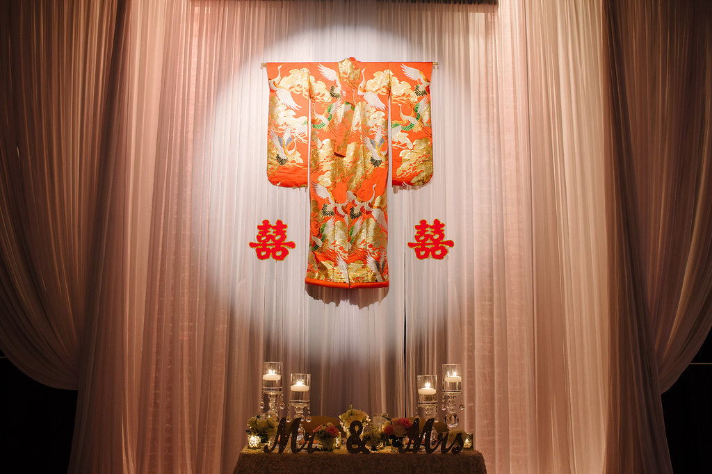 Multicultural Wedding Reception Sweetheart Table with Hanging Traditional Chinese Wedding Dress and Characters, White Draping, Oversized Votive Candles in Glass Holders and Mr and Mrs Signs   Downtown St Pete Wedding Reception Venue NOVA 535