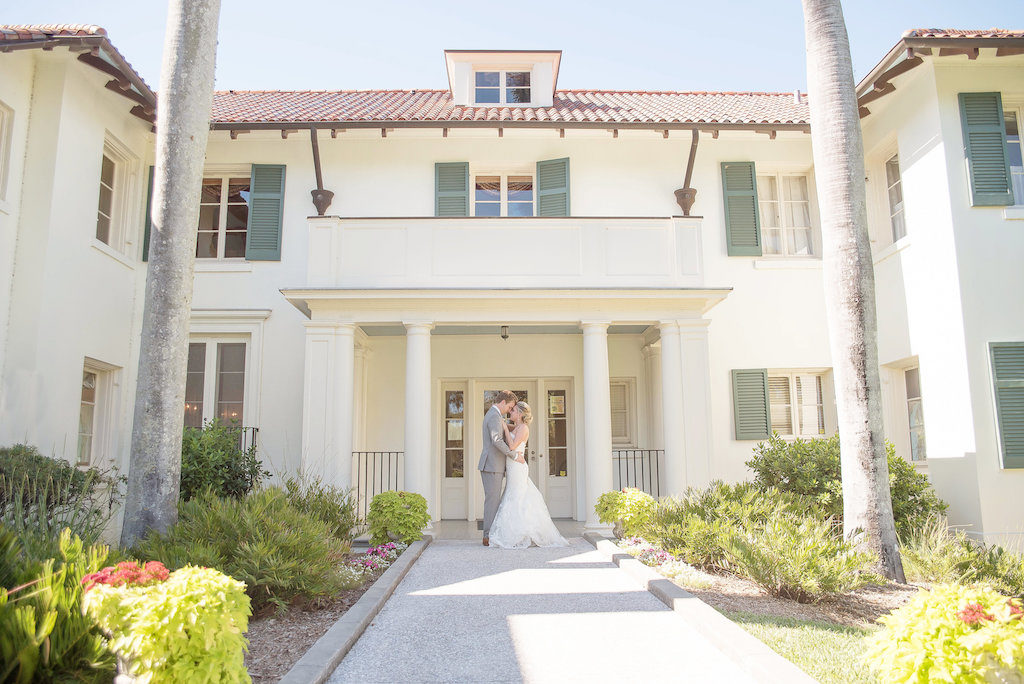 Outdoor Bride and Groom Wedding Portrait, Groom in Gray Suit, Bride in Lace Trumpet Allure Bridals Dress | Sarasota Wedding Photographer Kristen Marie Photography | Historic Venue The Edson Keith Mansion