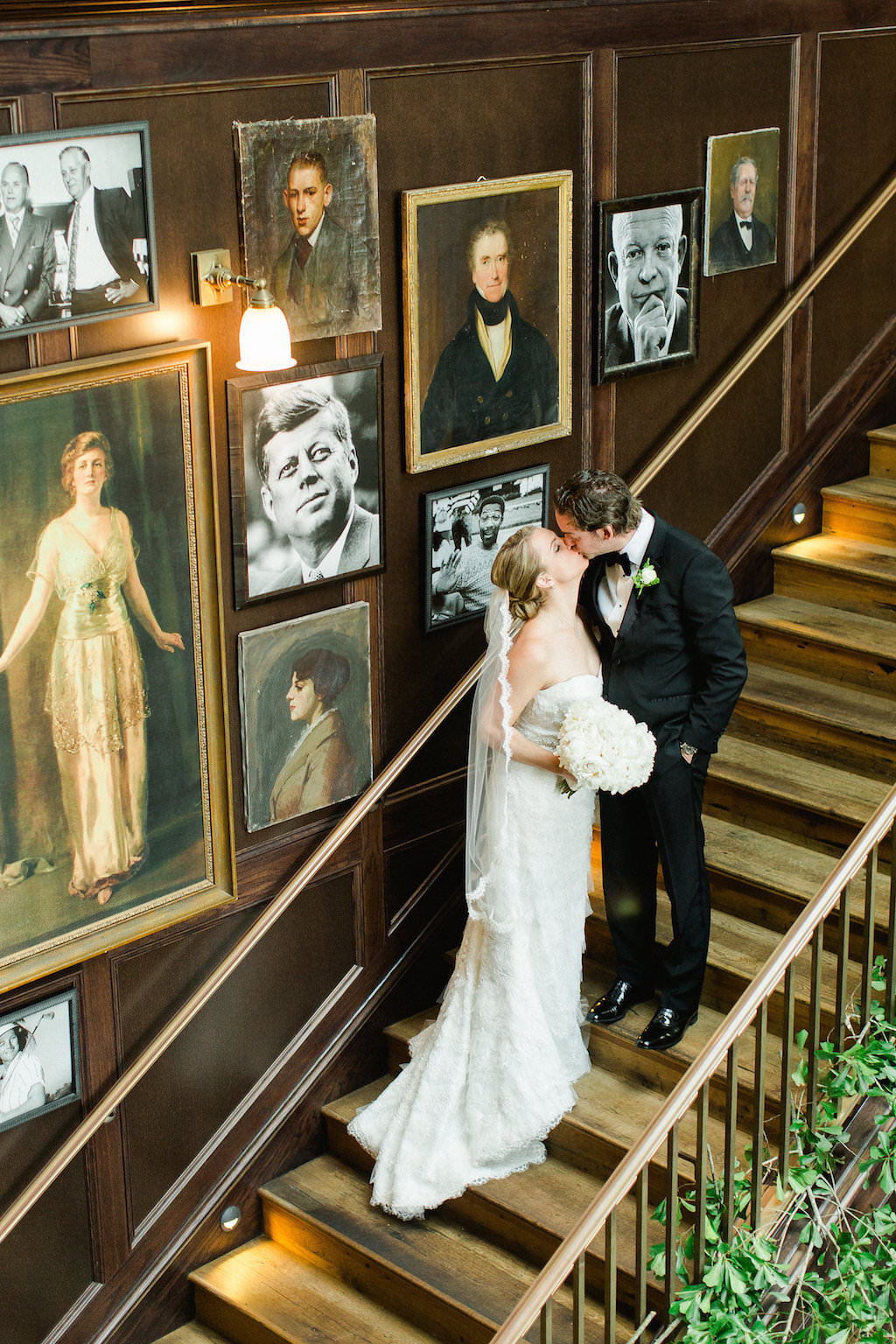 Indoor Staircase Bride and Groom Portrait with Vintage Portraits   Tampa Bay Wedding Photographer Ailyn La Torre Photography   Venue The Oxford Exchange