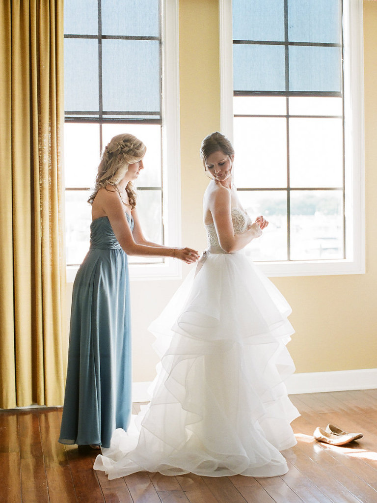Bride Getting Ready Portrait in Layered Ballgown Wedding Dress, Bridesmaid in Long Dusty Blue Dress | Tampa Wedding Venue The Westshore Yacht Club