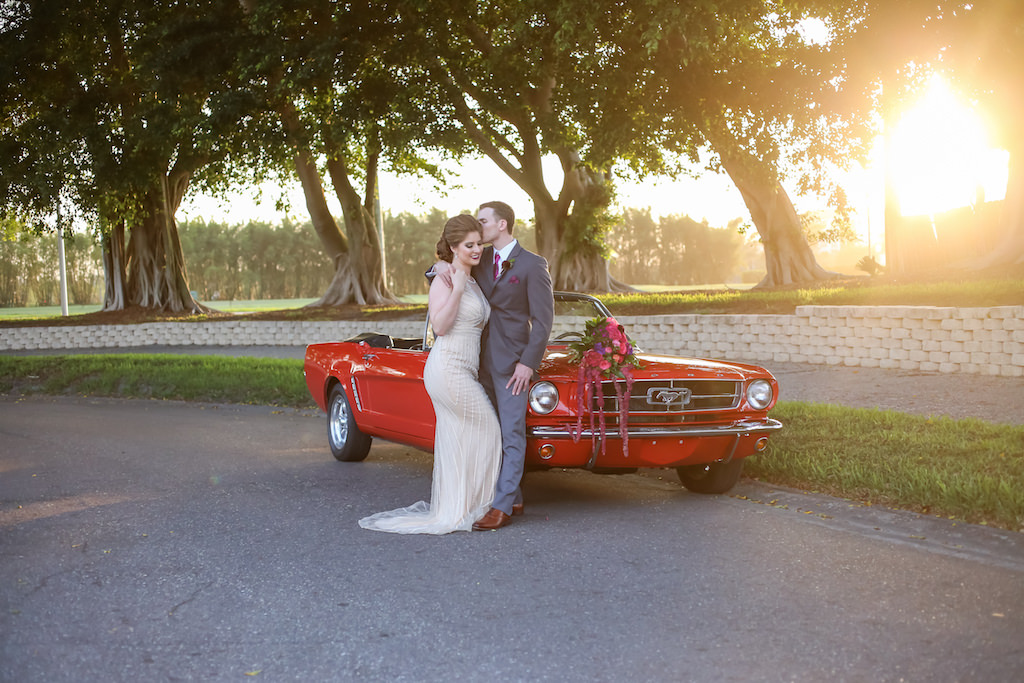 Bride and Groom Portrait with Pink, Fuchsia, Purple and Plum with Greenery Cascading Wedding Bouquet on Red Vintage Mustang Classic Car | Tampa Bay Wedding Florist Gabro Event Services | Planner Kelly Kennedy Weddings and Events | Photographer Lifelong Photography Studio