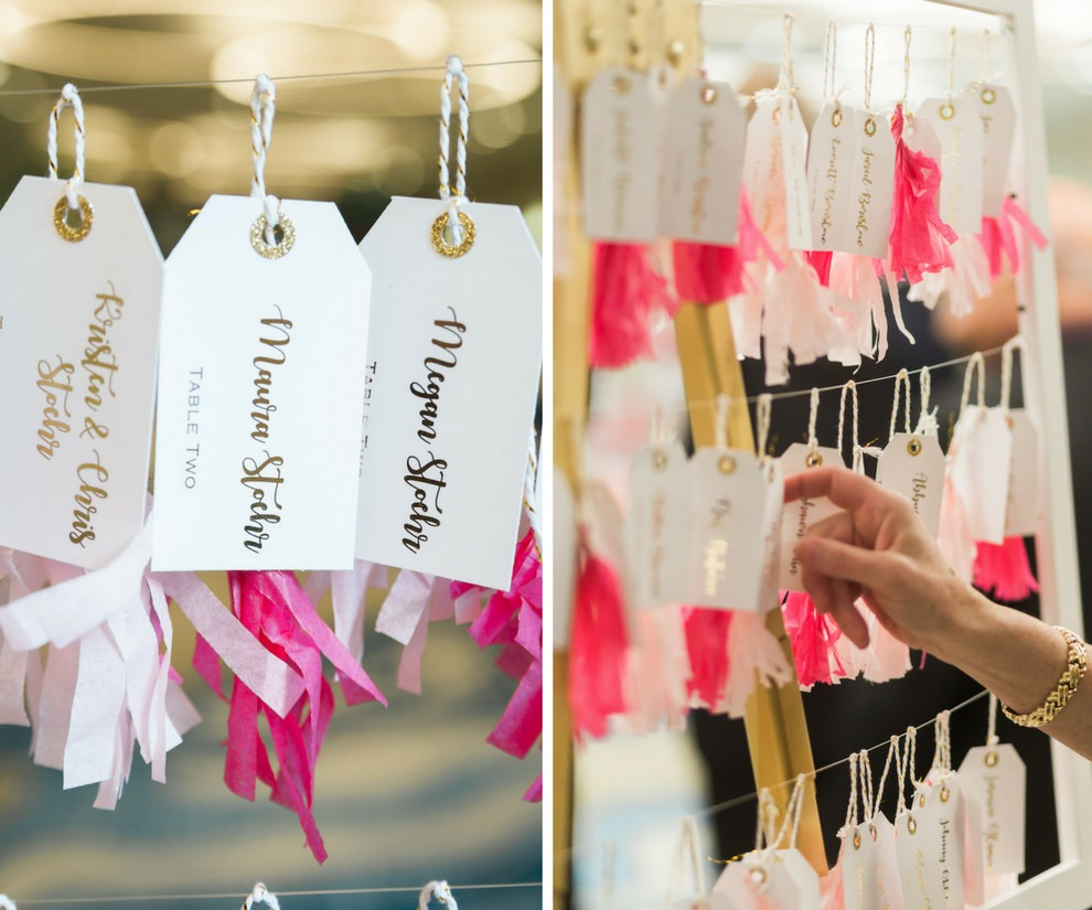 Whimsical Pink and Gold Wedding Foil Printed Luggage Tag with Tissue Paper Tassel Escort Cards on White Frame and Wire Hanger