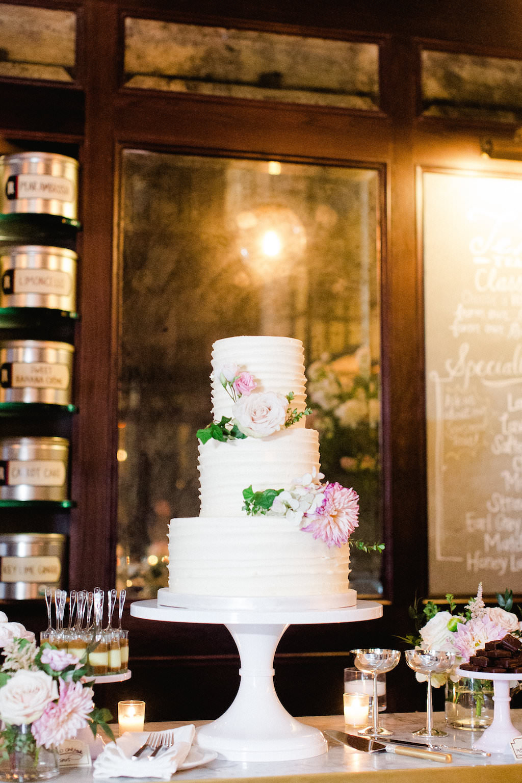 Ivory Garden Wedding Reception Dessert Table with Three Tier Round White Cake with Pink and White FLoral with Greenery on Round White Marble Cake Stand