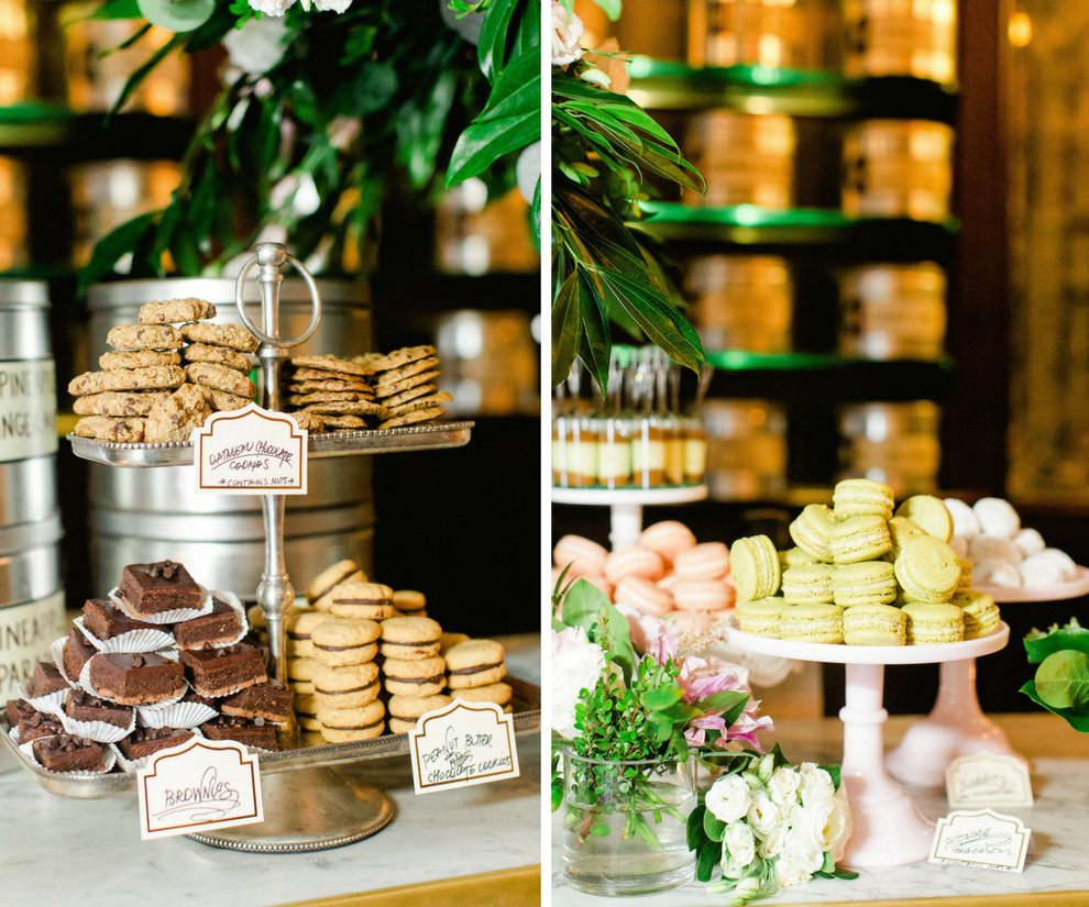 Garden Wedding Reception Dessert Table with Cookies, Brownies, Macaroons and Cake Shooters on Mismatched Vintage Stands with White, Pink, and Greenery Florals