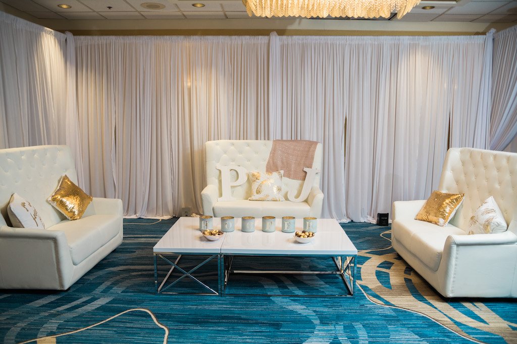 Pink and Gold Whimsical Wedding Reception with Stylish Highbacked White Lounge Loveseats, Gold Sequin Throw pillows, Rustic Glam Coffee Can Lanterns and Large Couple Initials   Tampa Bay Wedding Furniture Rentals and Draping Gabro Event Services   Hotel Ballroom Wedding Venue Hilton Clearwater Beach