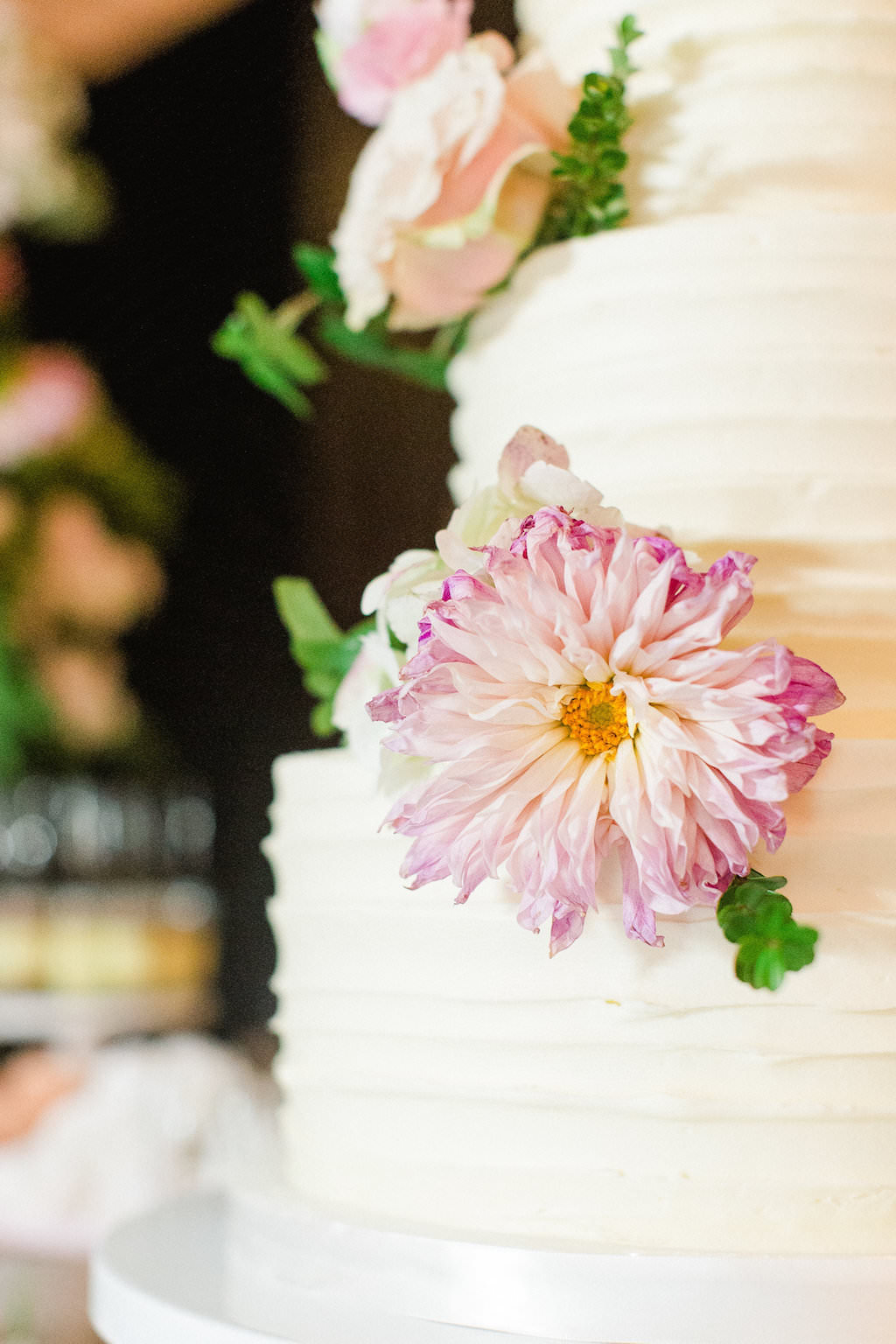 Round White Wedding Cake with Pink Flowers and Greenery