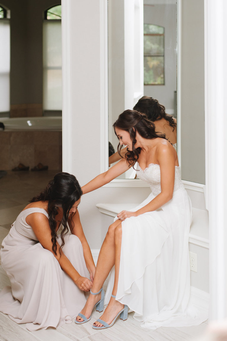 Bride Getting Dressed on Wedding Day