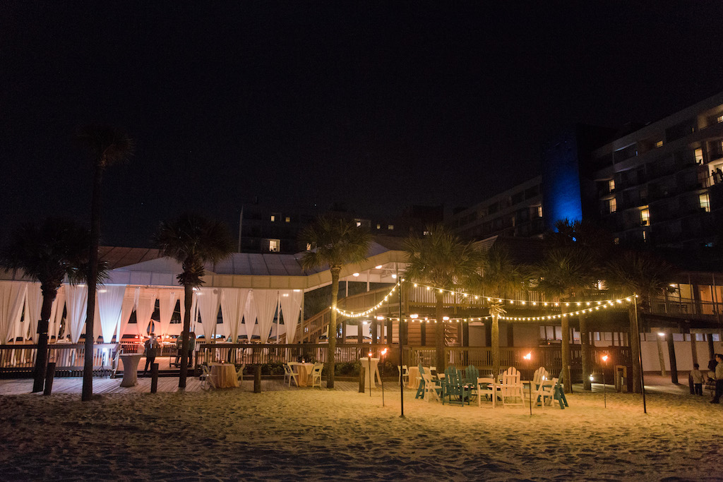 Outdoor Beach Wedding Lounge Area with String Lights and White Draping   Tampa Bay Venue The Hilton Clearwater Beach   Rentals Gabro Event Services