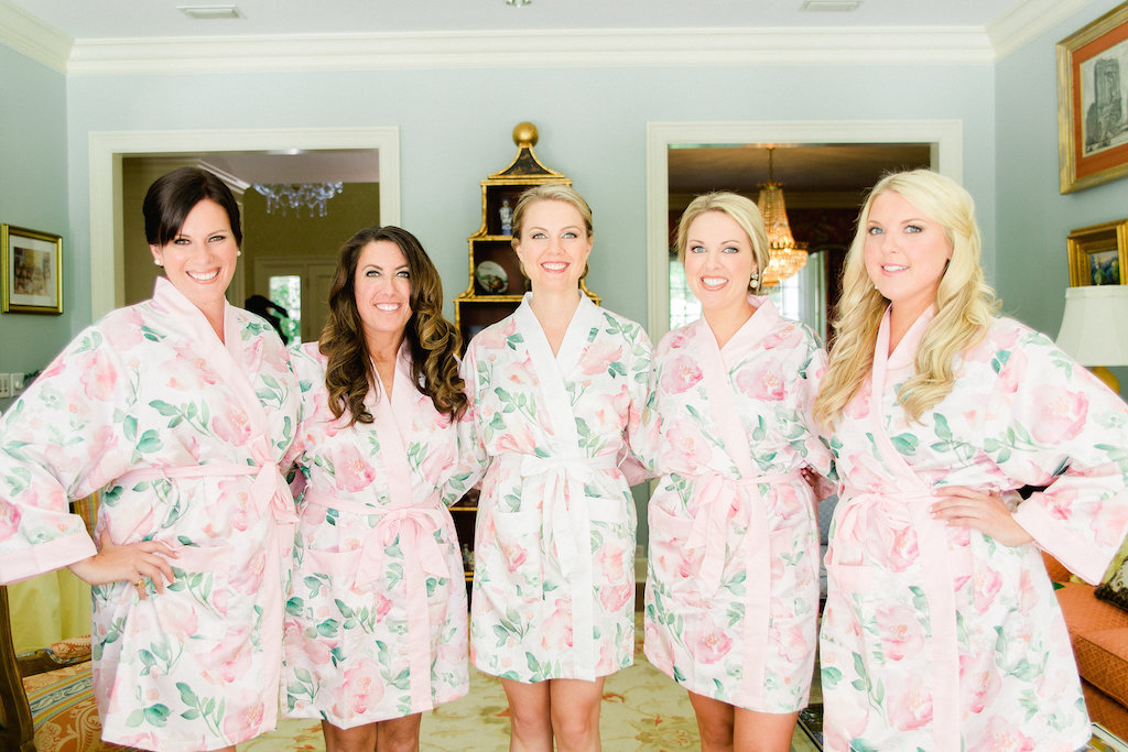 Indoor Bridal Party Portrait in Matching Rose Printed Silk Robes   Tampa Bay Wedding Photographer Ailyn La Torre Photography