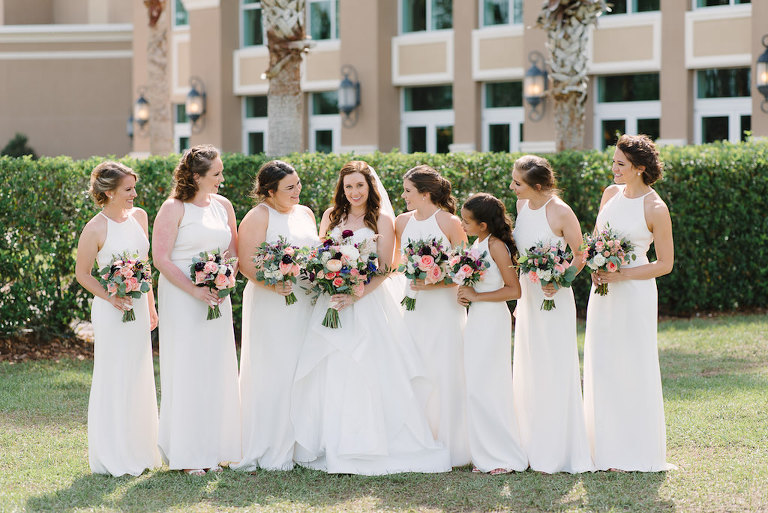 Outdoor Tampa Bridal Party Portrait, Bridesmaids in Halter White Floor length Dessy Dresses, with Peach, Purple, White and Pink Flower with Greenery Bouquets | Tampa Bay Bridesmaid Dress Shop Bella Bridesmaids
