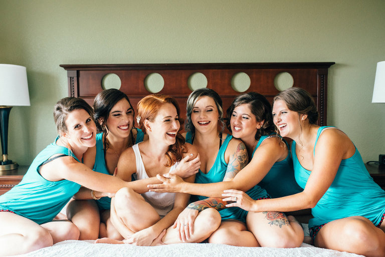 Hotel Interior Bridal Party Getting Ready Portrait in matching Teal Tank Top Pajamas