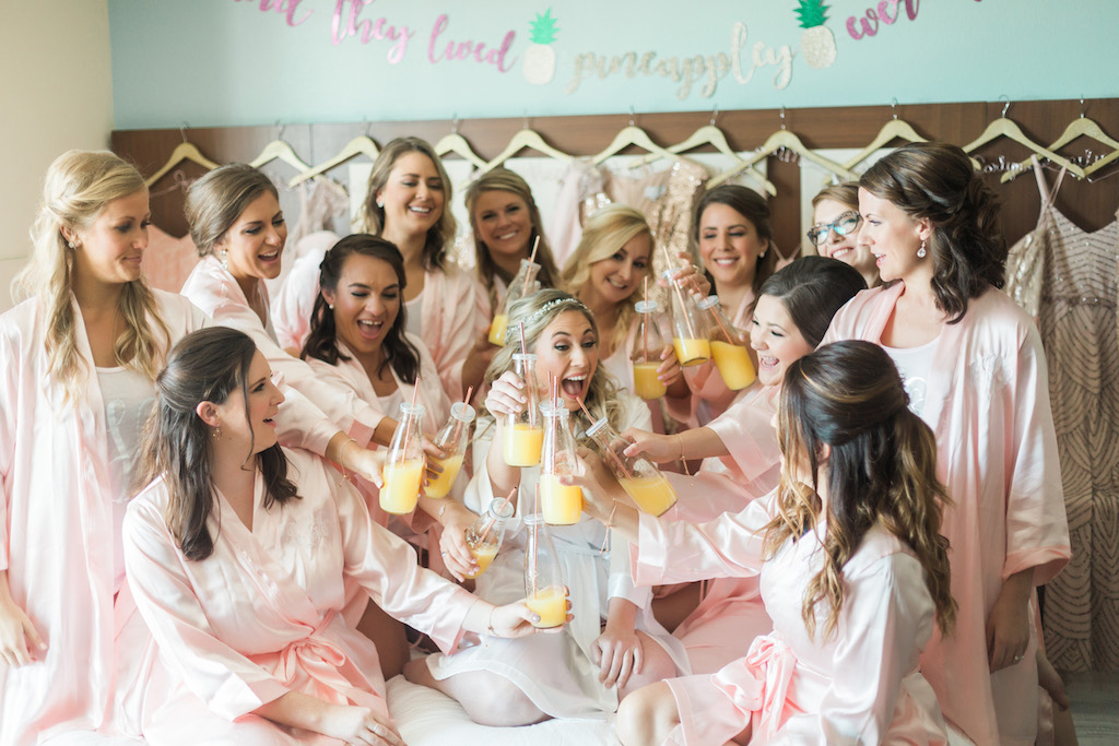 Indoor Bridal Party Getting Ready Portrait with Mimosas in Matching Pink Robes