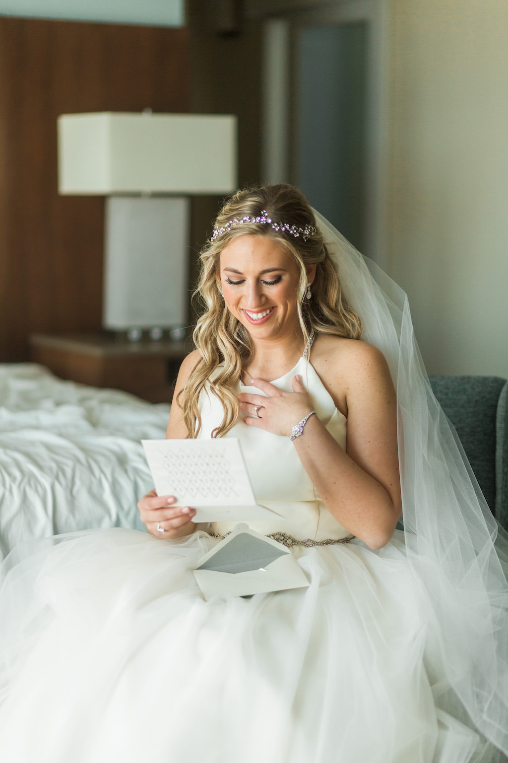 Bride Getting Ready Portrait Reading Letter from Groom, Wearing Halter Hayley Paige Wedding Dress and Jeweled Headpiece