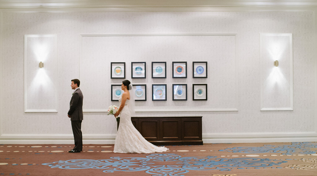 Hotel Interior Bride and Groom First Look Portrait, Bride in Strapless Allure Lace Dress