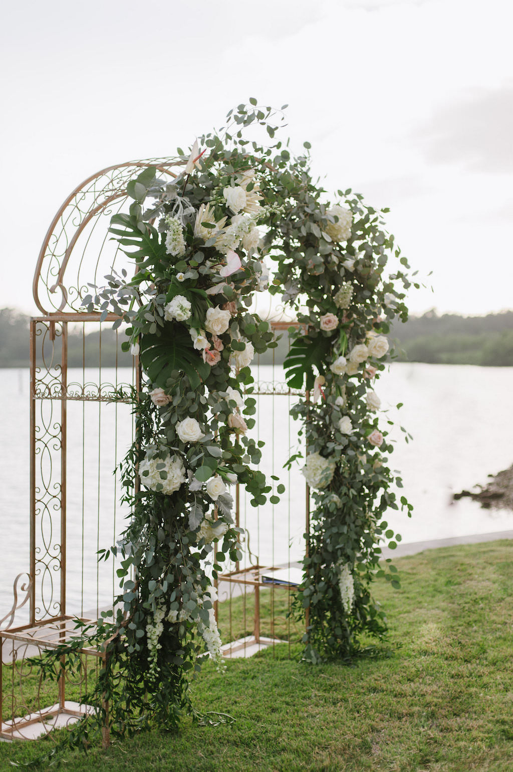 Organic Greenery Inspired Neutral Pastel Wedding Ceremony Arch for Outdoor Waterfront Wedding