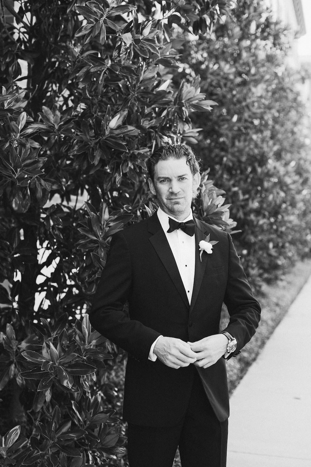 Outdoor Garden Groom Portrait wearing Black Tux with White Floral and Greenery Boutonniere   Tampa Bay Wedding Photographer Ailyn La Torre Photography