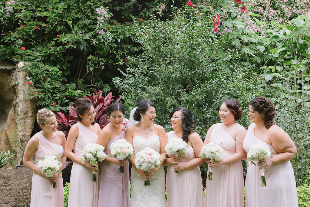 Outdoor Garden Wedding Bridal Party Portrait, Bridesmaids in One Shoulder Blush Pink Dresses, Bride in Strapless Lace Column Wedding Dress, with White and Blush Pink Rose Bouquets   St Pete Wedding Ceremony Venue The Sunken Gardens