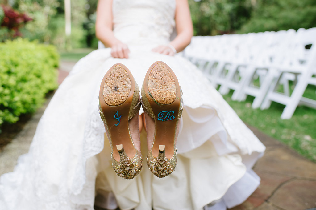 Outdoor Garden Wedding Ceremony Bridal Portrait wearing Jeweled Stiletto Shoes with Custom I DO in Blue Rhinestones on Soles