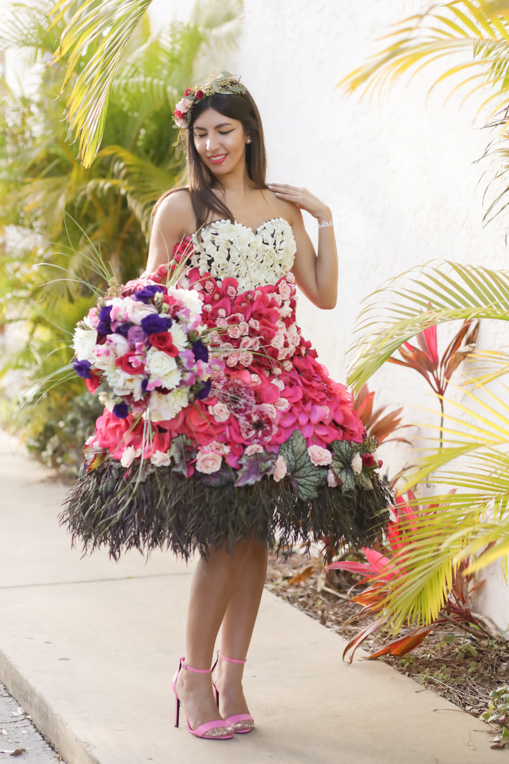 Outdoor Bridal Portrait in Creative Flower Dress with Pink, Fuchsia, Purple, Red and White Florals and Greenery with Bouquet, and Pink Open Toe Stiletto Heels   Tampa Wedding Florist Gabro Event Services   Photographer Lifelong Photography Studios