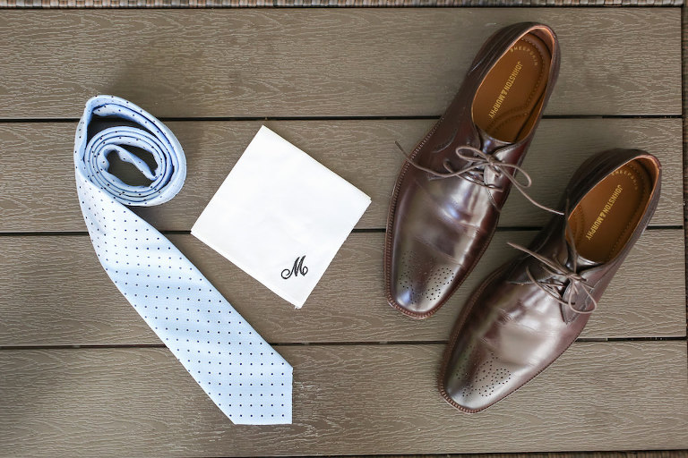 Grooms Wedding Details with Monogramed Handkerchief, Brown Leather Shoes, and Blue Polka Dot Tie