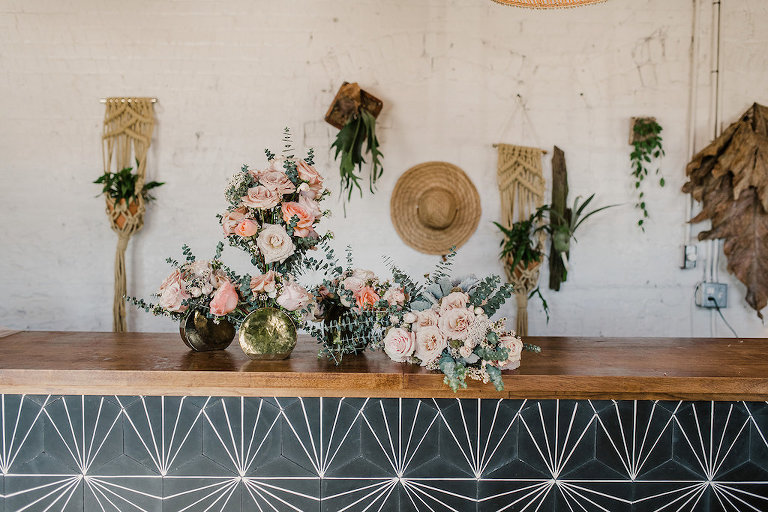 Green and Peach Floral Inspired Tampa Elopement with Rustic Wall Decor, Geometric Counter, and Small Rose and Mismatched Vase Flower Arrangements | Intimate Wedding Venue Fancy Free Nursery