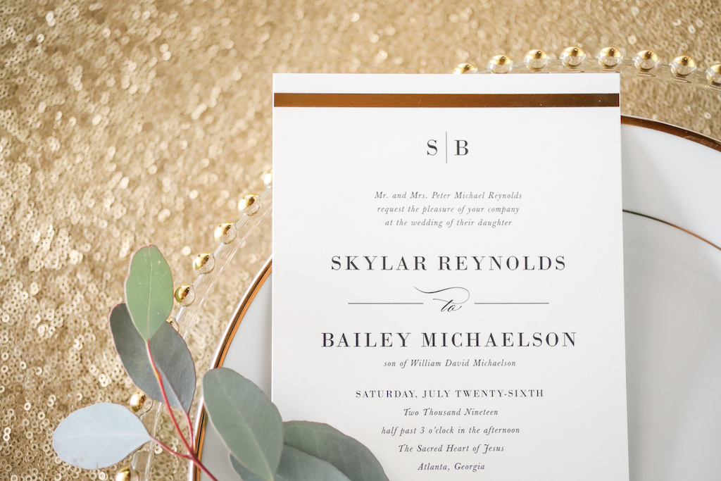 Elegant Gold Printed White Wedding Program with Black Script, on White Porcelain Place with Gold Beaded Glass Charger and Sequin Linen