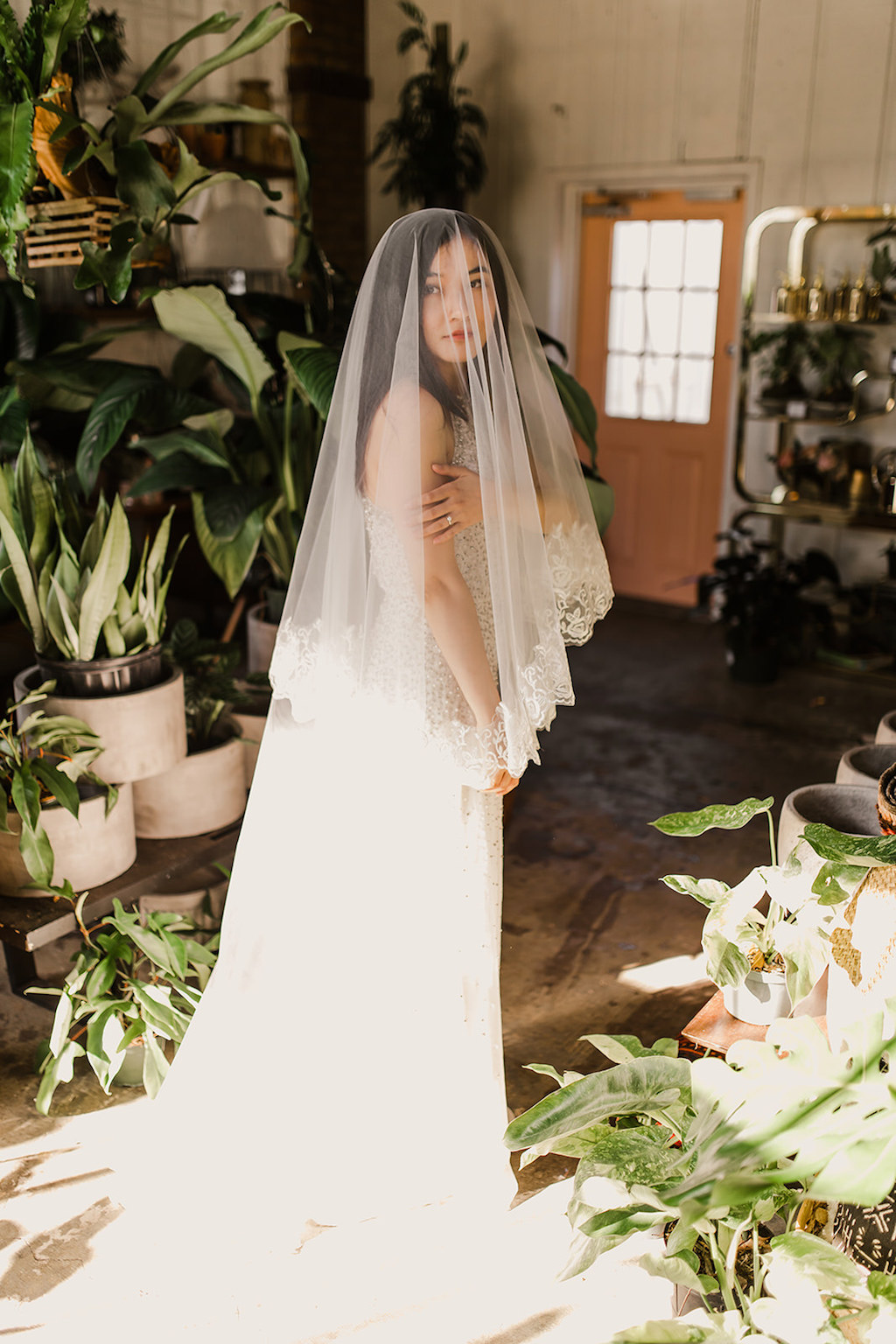 Indoor Bridal Portrait with Veil and Greenery | Tampa Intimate Wedding Venue Fancy Free Nursery