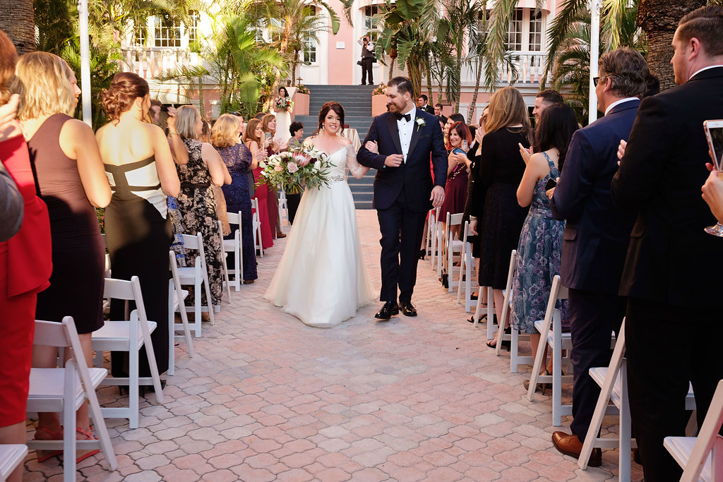 Outdoor Hotel Courtyard Wedding Ceremony with Blush Pink, White and Burgundy Bouquet with Greenery | Historic Waterfront Hotel St Pete Beach Wedding Venue The Don CeSar | Photographer Marc Edwards Photographs
