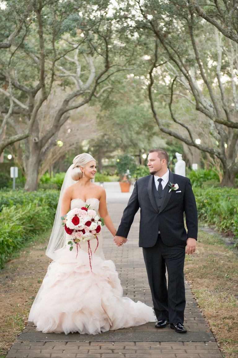 Outdoor Park Wedding Portrait, Bride in Blush Pink Strapless Layered Mermaid Wedding Dress with Red Rose, Blush Pink and White Floral and Greenery Bouquet, Groom in Black Suit with White and Red Boutonniere | Tampa Bay Wedding Photographer Andi Diamond Photography | Hair and Makeup Michele Renee The Studio