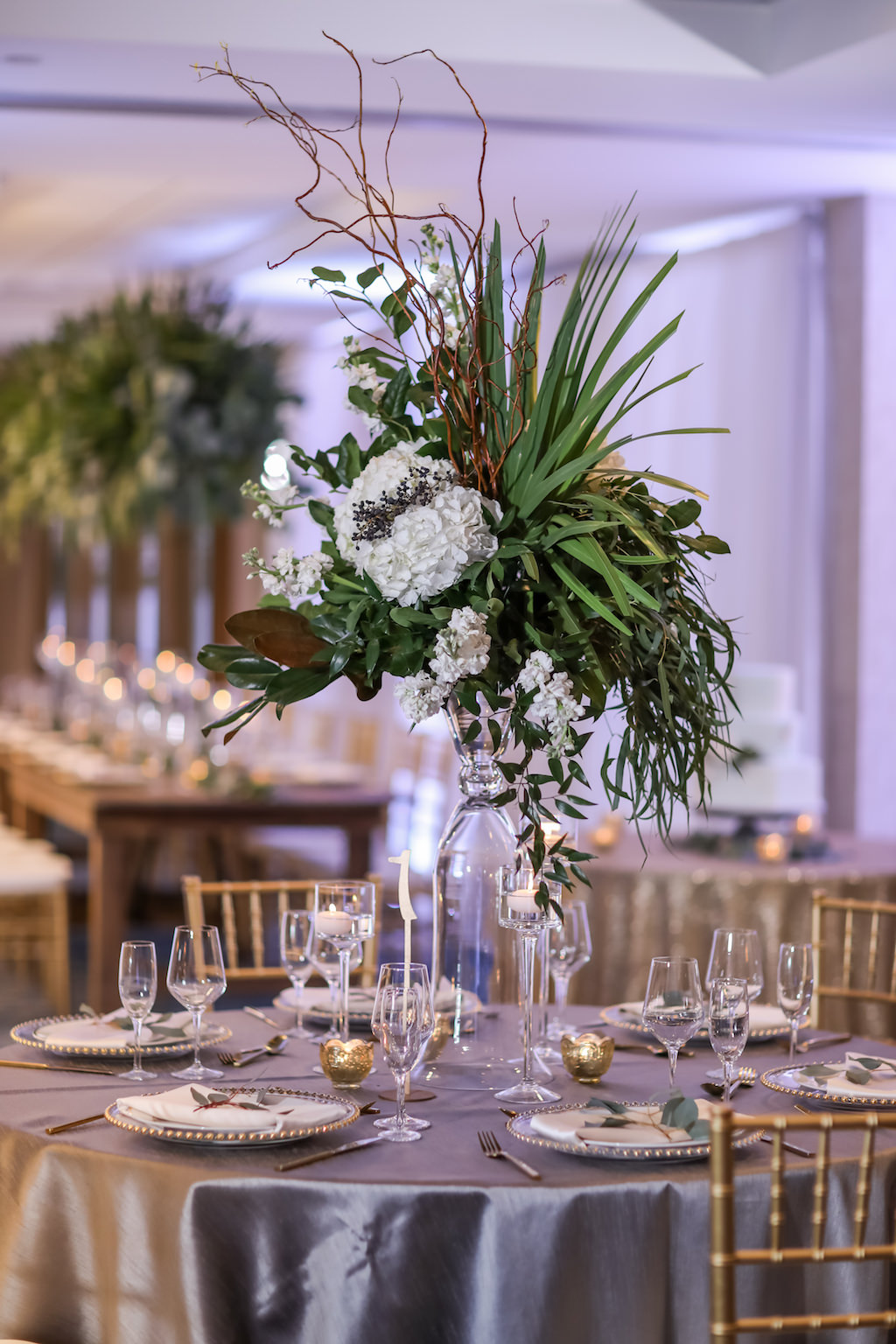 Hotel Ballroom Wedding Reception Round Table Decor with Tall White Floral, Tropical Greenery and Natural Branches Centerpiece in Unique Glass Vase, with Gray Satin Linens   Tampa Bay Waterfront Hotel Venue Hilton Clearwater Beach