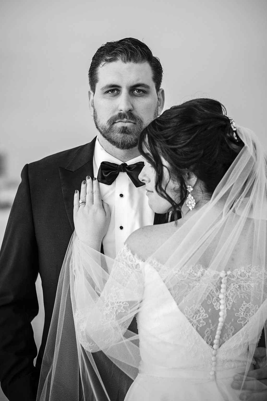 Outdoor Bride and Groom Wedding Portrait, Bride in Lace Sleeve Illusion Back Wedding Dress | St Pete Beach Wedding Venue The Don CeSar | Tampa Bay Photographer Marc Edwards | Bridal Hair and Makeup Femme Akoi Studio
