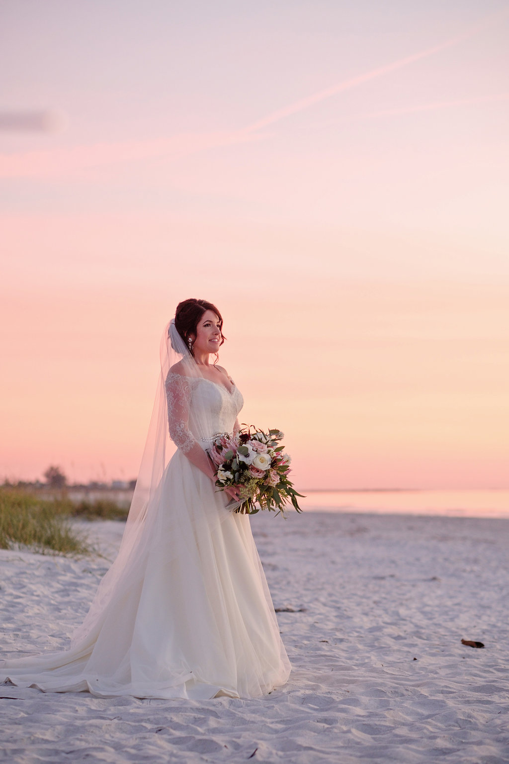 Outdoor Beach Sunset Bridal Portrait in A Line Wedding Dress with White, Pink, and Burgundy with Greenery Bouquet | St Petersburg Wedding Photographer Marc Edwards Photography | Hair and Makeup Femme Akoi Beauty Studio