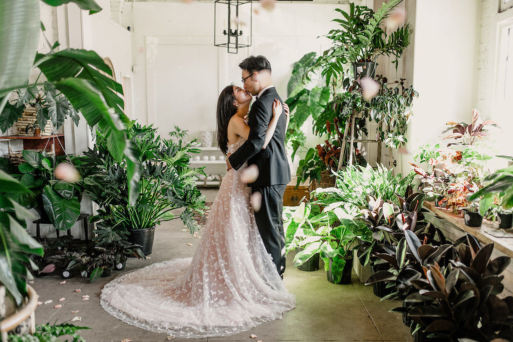 Indoor Wedding Ceremony Portrait, Bride in Peach and White Lace Wedding Dress, with living Greenery | Tampa Intimate Elopement Venue Fancy Free Nursery