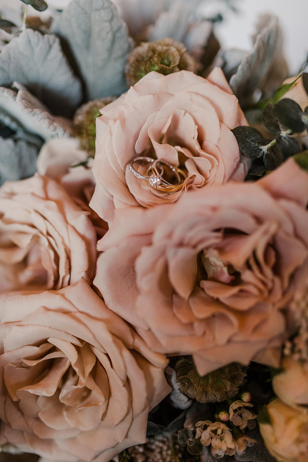 Diamond Engagement Ring and Wedding Bands on Peach Roses