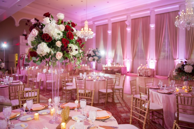 Country Club Ballroom Wedding Reception, with Red, Pink and White and Greenery Tall Centerpiece, Oversized Gold Glitter Table Numbers, and Gold Chiavari Chairs | Tampa Bay Wedding Venue Palma Ceia Golf and Country Club