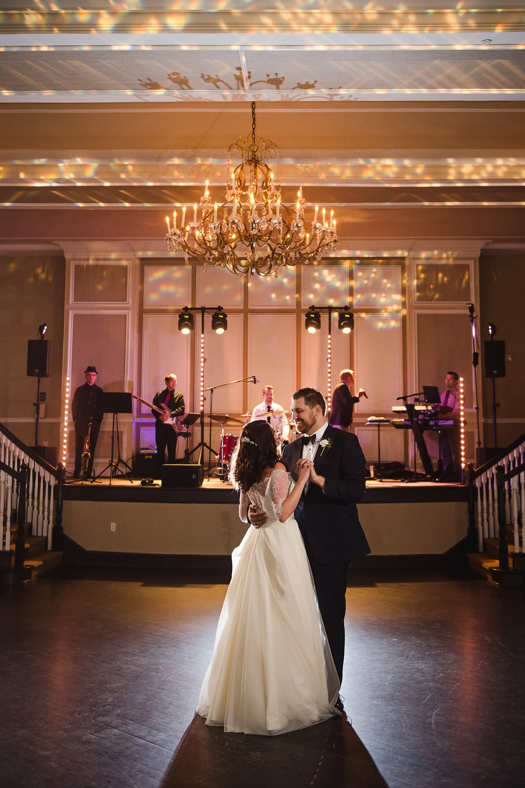 Hotel Ballroom Wedding Reception First Dance, with Gobo Ceiling Lights and Tampa Bay Wedding Band Phase 5 | St Pete Wedding Planner Parties A La Carte | Historic Venue The Don CeSar | Photographer Marc Edwards Photographs