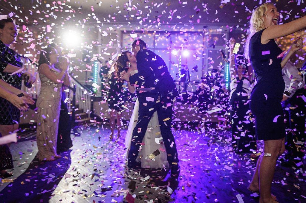 Hotel Ballroom Wedding Reception First Dance Portrait, with Confetti Bomb | St Pete Wedding Planner Parties A La Carte | Historic Venue The Don CeSar | Photographer Marc Edwards Photographs