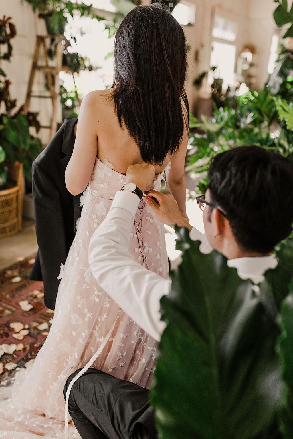 Bride Getting Ready Portrait in Strapless Peach Colored Wedding Dress | Intimate Tampa Wedding Venue Fancy Free Nursery