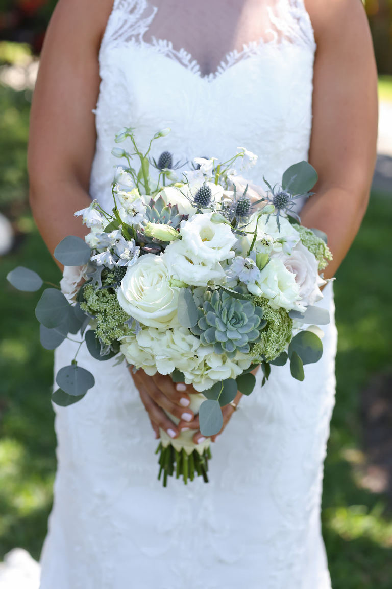 Outdoor Bridal Portrait wearing Lace Neckline Column Wedding Dress with White and Greenery Bouquet with Thistle and Succulents | Tampa Bay Wedding Photographer Lifelong Photography Studios