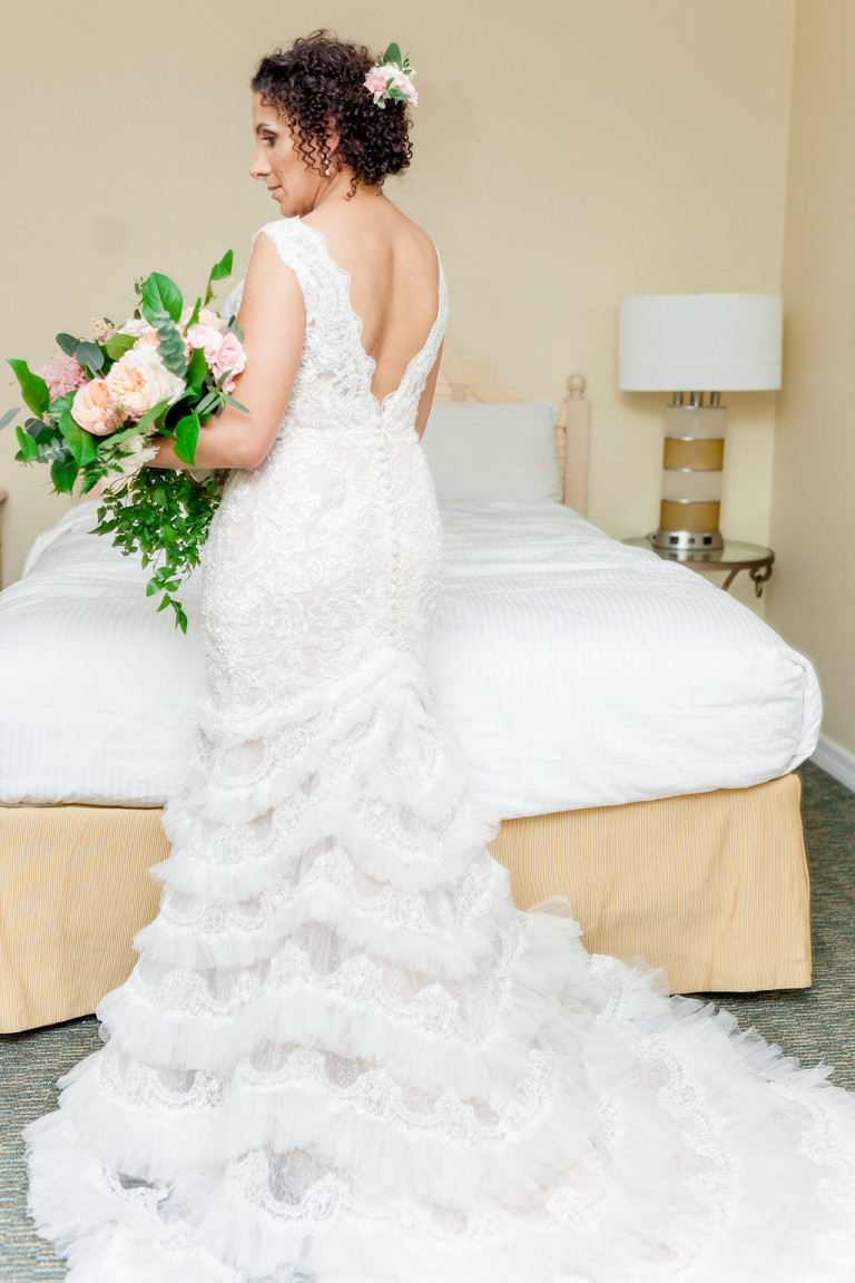 Indoor Bridal Portrait in Open Back A Line Fringe David's Bridal Wedding Dress with Peach Rose and Greenery Bouquet | St Pete Wedding Florist Cotton and Magnolia